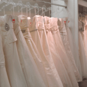 Racks of beautiful donated wedding gowns